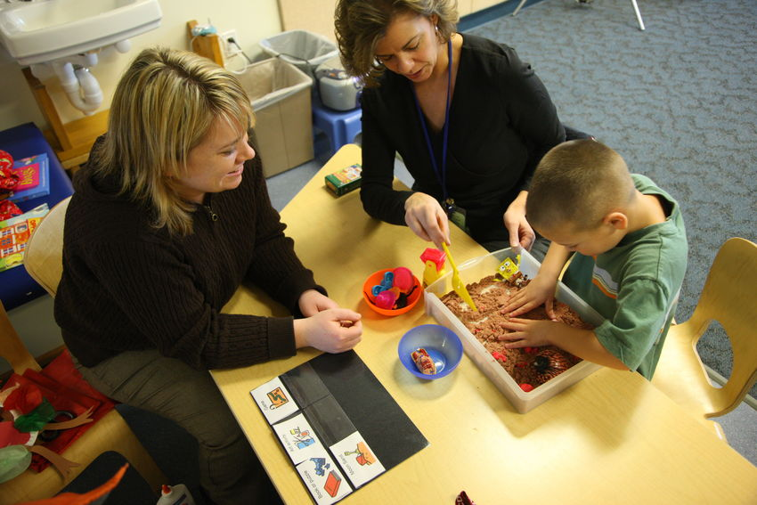 Developmental Services - Playing at Desk