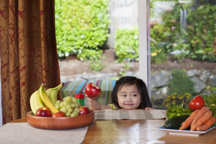 Girl Eating apple at table - 6404_MBCH_WomanandChildren_06_2013_095
