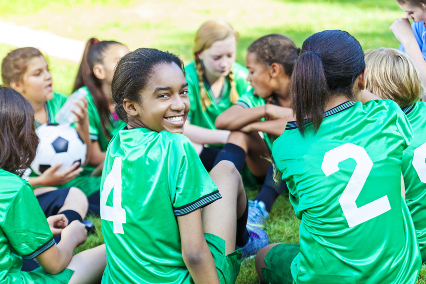 Girls in Green Sitting - Soccer