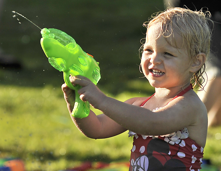 Little Girl Playing Squirt Guns